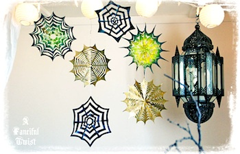 A Fanciful Twist cut paper spider webs