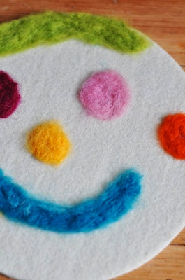 Lilla A needlefelted happy face mat