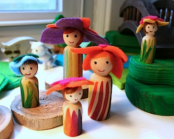 Pink and Green Mama spring peg dolls