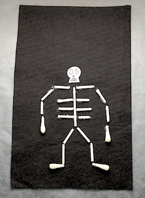 The Crafty Crow q-tip skeleton on felt