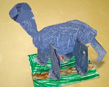 Use Your Coloured Pencils cardboard dinosaur statues