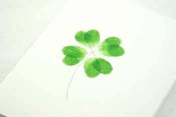 Child Made fingerprint shamrocks