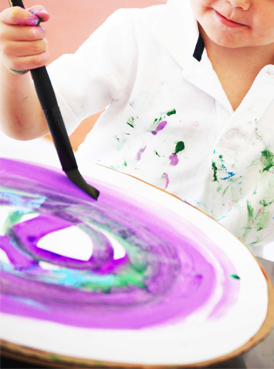 Small Hands Big Art spiral painting with a lazy susan