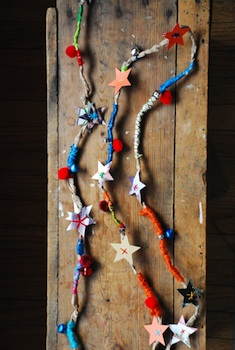 recycled paper bag rope garland with colorful yarn and paper stars