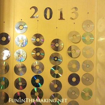 new year's eve photo backdrop with recycled CDs