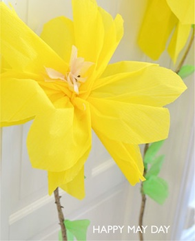 yellow crepe paper flowers on twigs