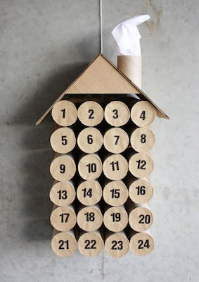 stacked toilet paper rolls made into a house advent calendar tutorial