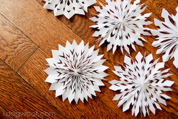 medallion snowflakes made from folded paper tutorial