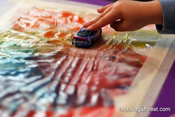 mess free finger painting under plastic wrap or in a baggy