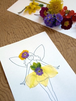 fairy drawing decorated with flower petals