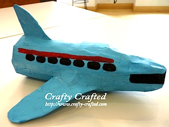 papier mache and plastic bottle airplane
