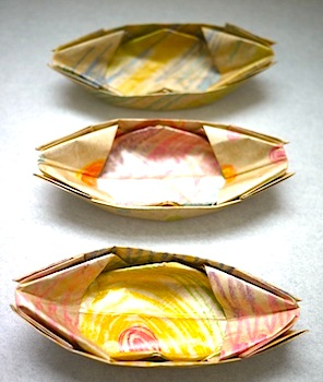 origami paper boats coated in wax