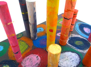 wood dowels decorated with oil pastels sculpture garden