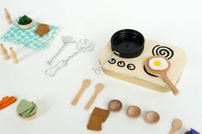 miniature kitchen set in a mint tin