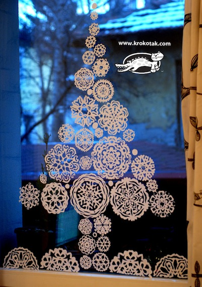 paper snowflake tree in a window