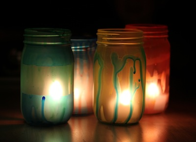 Solstice Lanterns Made From Glass Jars And Colored Mod Podge