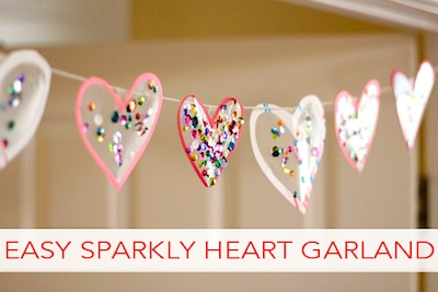 kids valentine craft sparkly heart garland made from clear contact paper