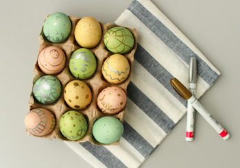 Easter eggs decorated with metallic pen art
