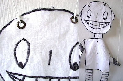 fabric puppet with child's artwork