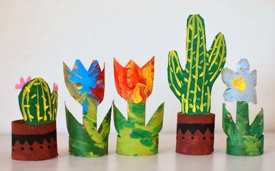 toilet paper roll cut and painted to look like cactus and flowers