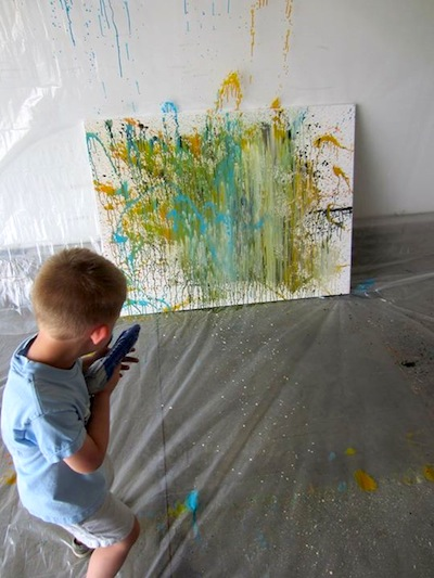 squirt gun painting outside activity for kids