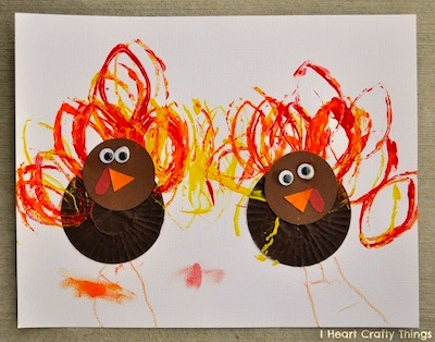 cupcake liner turkey craft with cardboard tube stamped feathers
