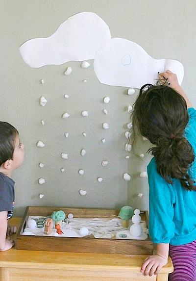 winter playscape set up with salt, cotton balls, and styrofoam snowmen DIY