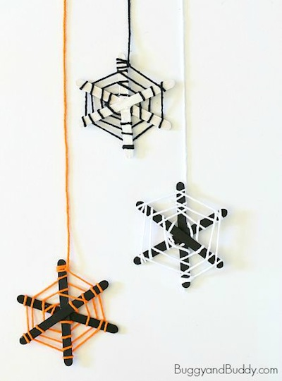popsicle stick and yarn spider web Halloween craft