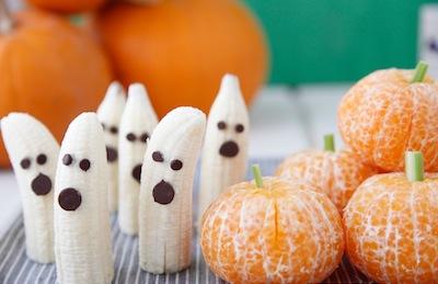 healthy Halloween party treats banana ghosts and orange pumpkins