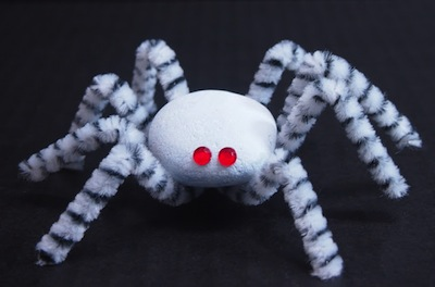 rock and chenille stem spider craft