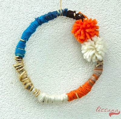 simple autumn wreath made of branches and yarn
