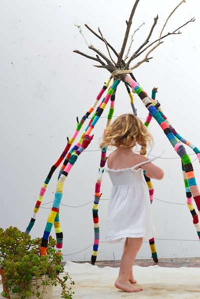 yarn wrapped branches teepee