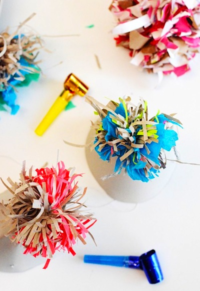 wrapping paper pompom party hat toppers for New Year's Eve craft for kids